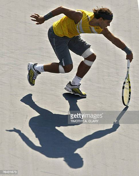Second seed Rafael Nadal of Spain lunges for a return to Alun Jones of Australia during their first round match at the US Open Tennis Championships...