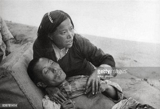 Second SinoJapanese War Chinese woman with her dying husband Ca 1940