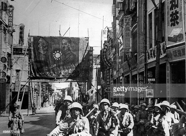 Second SinoJapanese War Japanese occupation of Canton Japanese soldiers patrolling the streets to root out remnants of defeated Chinese soldiers and...
