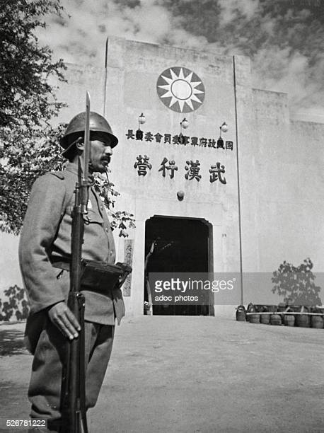 Second SinoJapanese War The former headquarter of Chiang Kaishek gaurded by a Japanese sentinel in Wuchang In 1938