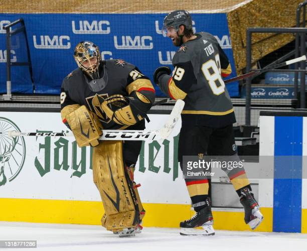Second star of the game Alex Tuch of the Vegas Golden Knights greets teammate Marc-Andre Fleury as he takes to the ice after being named the first...