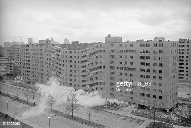 A second story building in the massive PruittIgoe public housing complex is demolished by dynamite here Dynamite charges placed under each pillar of...