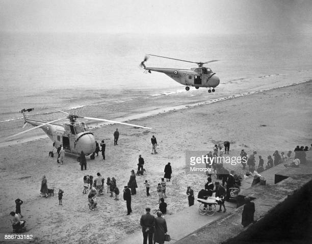 A second Westland Whirlwind helicopter brings assistance to the RAF air sea rescue helicopter of D flight 202 Squadron from RAF Leconfield which...