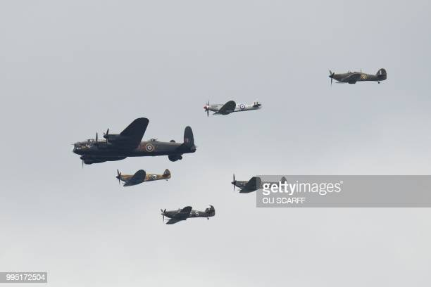 A Second World War Lancaster bomber and spitfires fly in formation on the centenary of the formation of the RAF on the eighth day of the 2018...