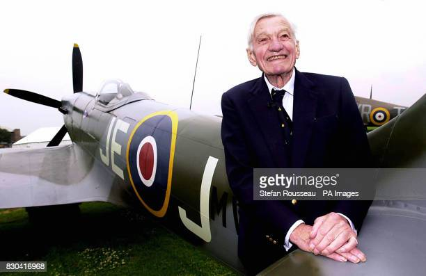 Second World War RAF Spitfire pilot Johnnie Johnson with a Spitfire Mk XIV which has been painted with his initials to represent his own aircraft...
