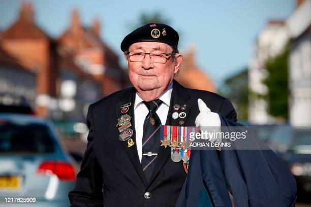 Second World War veteran Fred Lee gestures on his way to attend a short service of remembrance and wreathlaying at the war memorial in Odiham on June...