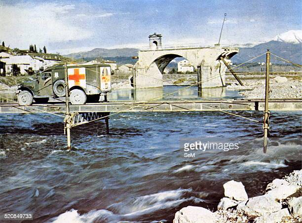 Second World WarItaly 1943 Ambulance of the red cross ally cross a river in southern Italy devastated by bombing