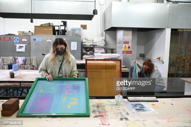Second year students studying textiles and surface design work during a session at the University of Bolton in Bolton, northwest England, on March...