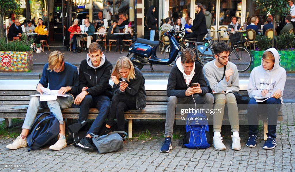 Secondary school boys studying together with mobile phones. : Stock Photo