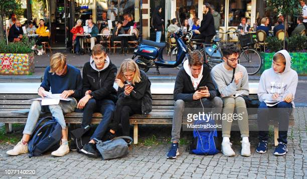secondary school boys studying together with mobile phones. - candid forum stock pictures, royalty-free photos & images