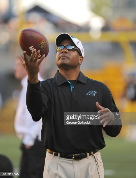 Secondary/pass defense coordinator Steve Wilks of the Carolina Panthers tosses a football in the air during pregame warmup before a preseason game...