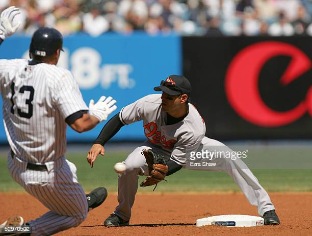 Secondbase Brian Roberts of the Baltimore Orioles moves to tag out Alex Rodriguez of the New York Yankees at Yankee Stadium on April 9 2005 in Bronx...