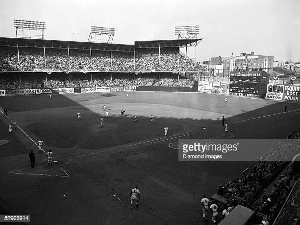 Secondbaseman Billy Martin of the New york Yankees rushes in to snag the pop up off the bat of Jackie Robinson of the Brooklyn Dodgers during the...
