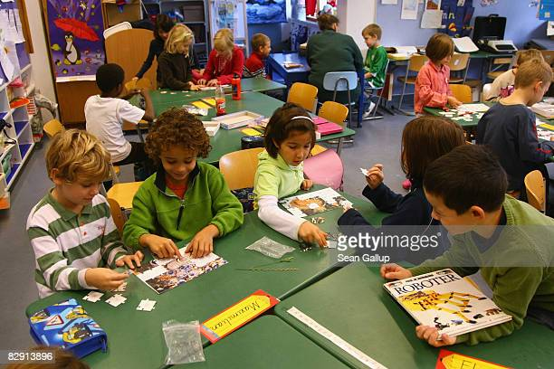 Secondgrade children attend class in the elementary school at the John F Kennedy Schule duallanguage public school on September 18 2008 in Berlin...