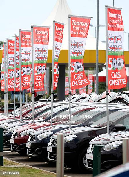 Secondhand Nissan Qashqai SUV automobiles produced by Nissan Motor Co stand parked for sale beneath promotional banners outside Toomey Motor Group's...