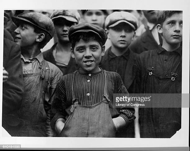 Secondino Libro 10 or 11 years old poses with a group of his coworkers at a textile mill in Lawrence Massachusetts USA