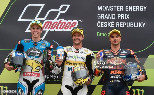 Secondplaced Alex Marquez of Spain winner Thomas Luthi of Switzerland and thirdplaced Miguel Oliveira of Portugal celebrate on the podium after the...