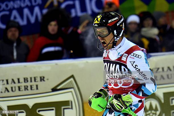 Secondplaced Austria's Marcel Hirscher reacts in the finish area of the Men's Slalom during the FIS Alpine World Cup on December 22 in Madonna di...