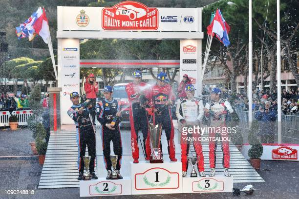 Secondplaced Belgian codriver Nicolas Gilsoul and driver Thierry Neuville winners French codriver Julien Ingrassia and driver Sebastien Ogier and...