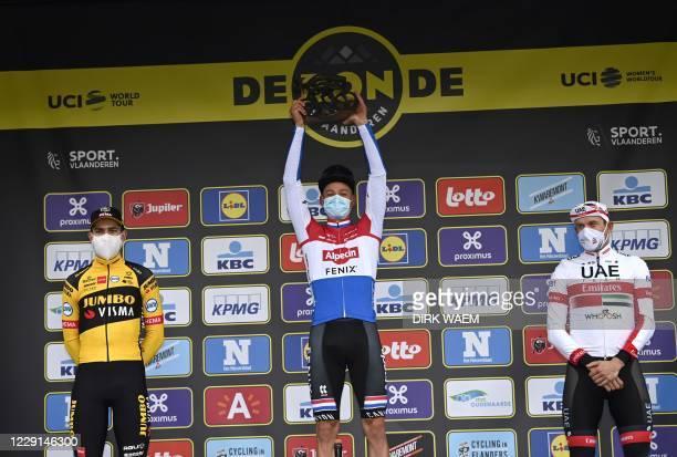 Second-placed Belgian Wout Van Aert of Team Jumbo-Visma, first-placed Dutch Mathieu van der Poel of Alpecin-Fenix and third-placed Norwegian...