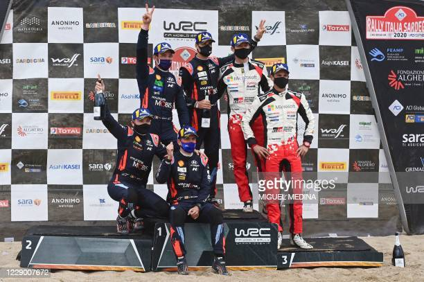 Second-placed Belgium co-driver Nicolas Gilsoul and Belgium driver Thierry Neuville, winners Spain's co-driver Carlos Del Barrio and Spain's driver...