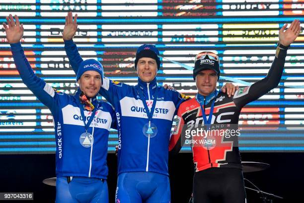 Secondplaced Belgium's Philippe Gilbert winner Netherland's Niki Terpstra and thirdplaced Belgium's Greg Van Avermaet celebrate on the podium of the...