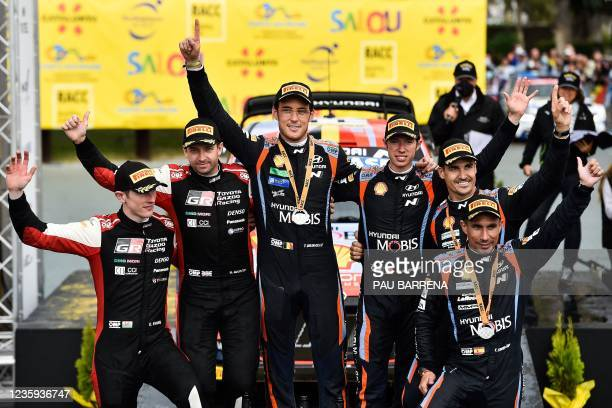 Second-placed Britain's driver Elfyn Evans and co-driver Scott Martin of Toyota Gazoo Racing WR, winners Belgium's Thierry Neuville and co-driver...