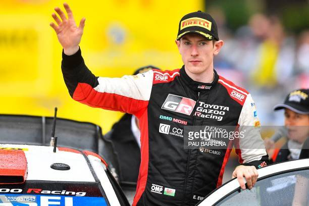 Second-placed Britain's driver Elfyn Evans of Toyota Gazoo Racing WRT, waves during the podium ceremony after the Catalonia 2021 FIA World Rally...