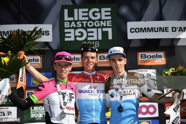Secondplaced Canadia's Michael Woods of EF Education First Drapac Cannondale winner Luxembourg's Bob Jungels of QuickStep Floors and thirdplaced...