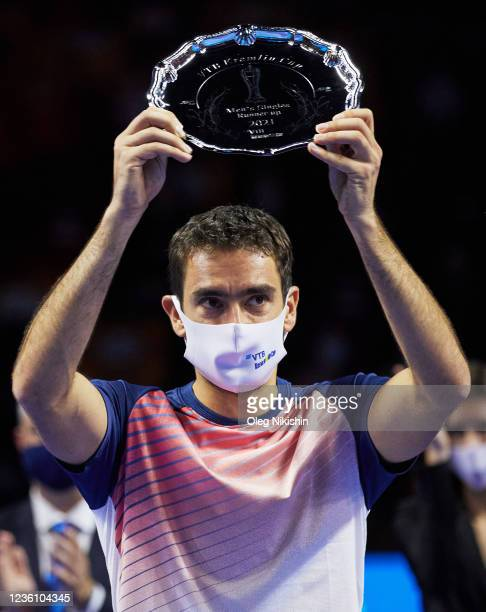 Second-placed Croatia's Marin Cilic poses with a trophy after the men's singles final tennis match against Marin Cilic of Croatia during on Day Seven...