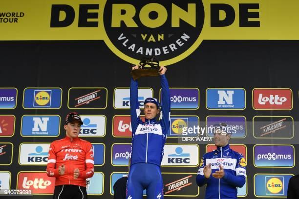 Second-placed Danish rider Mads Pedersen of Team Trek-Segafredo, winner Dutch rider Niki Terpstra of Team Quick-Step Floors and third-places Belgian...