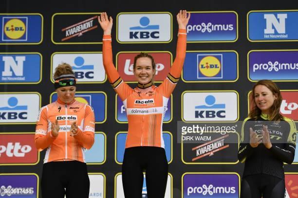 Second-placed Dutch rider Amy Pieters, winner Dutch rider Anna van der Breggen and third-placed Dutch rider Annemiek Van Vleuten celebrate on the...