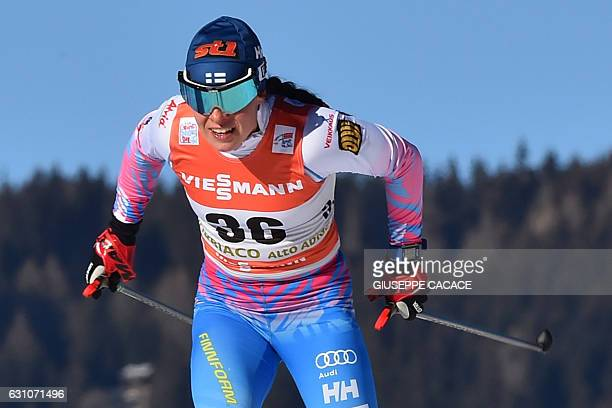 Secondplaced Finland's Krista Parmakoski competes in the Women's 5 km individual free competition of the Tour de Ski Cross Country World Cup on...