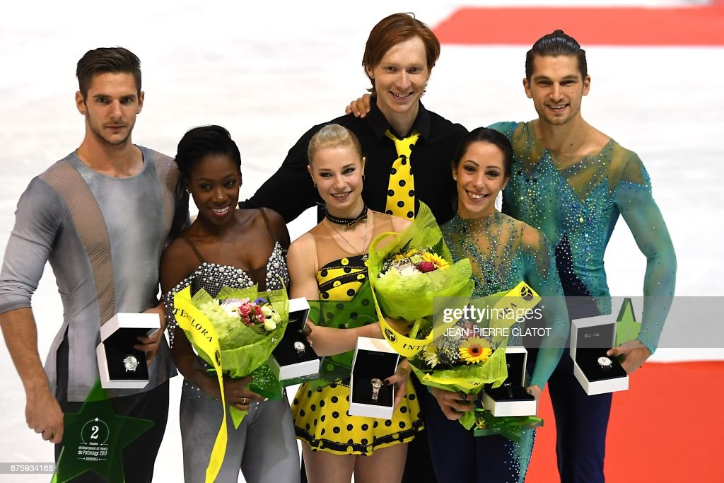 Second-placed France's Vanessa James and Morgan Cipres, first-placed Russia's Evgenia Tarasova and Vladimir Morozov, third-placed Italia's Nicole Della Monica and Matteo Guarise during the price ceremony after competing in the Pair Free Skating as part of the Internationaux de France ISU Grand Prix of Figure Skating in Grenoble, central-eastern France, on November 18, 2017. /