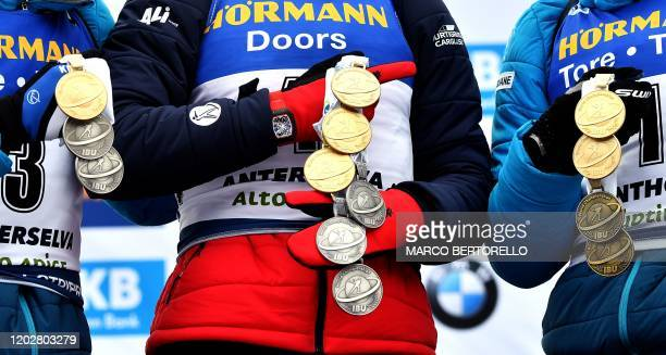 Secondplaced French Quentin Fillon Maillet winner Norwegian Johannes Thingnes Boe and thirdplaced French Emilien Jacquelin celebrate with the medals...