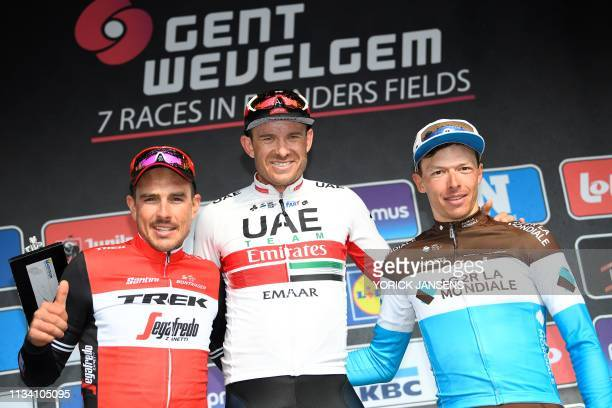 Secondplaced German John Degenkolb of the TrekSegafredo team firstplaced Norwegian Alexander Kristoff of the UAE team Emirates and thirdplaced...