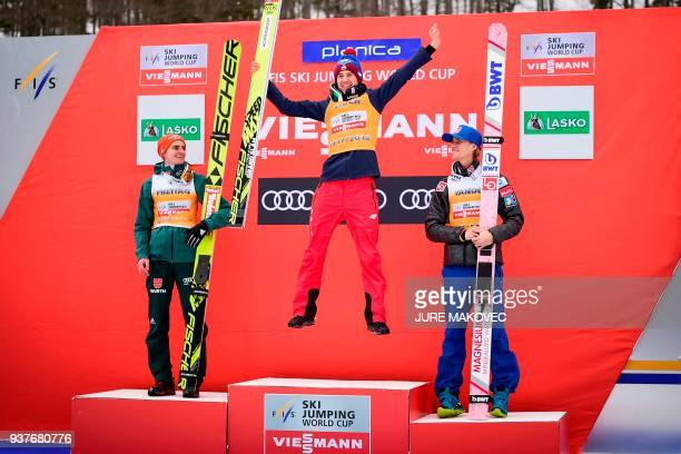 Second-placed Germany's Richard Freitag, overall FIS Ski Jumping World Cup winner Poland's Kamil Stoch and third-placed Norway's Daniel Andre Tande...