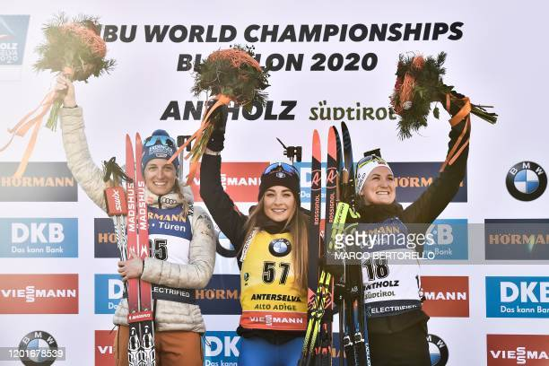 Secondplaced Germany's Vanessa Hinz winner Italy's Dorothea Wierer and thirdplaced Norway's Marte Olsbu Roeiseland pose on the podium after the IBU...