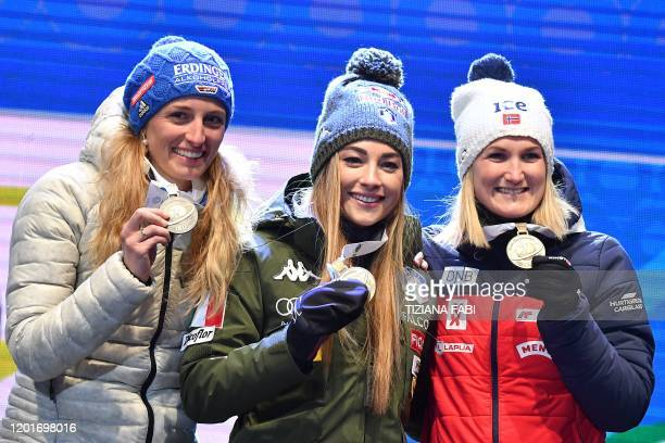 Secondplaced Germany's Vanessa Hinz winner Italy's Dorothea Wierer and thirdplaced Norway's Marte Olsbu Roeiseland pose with their medal on the...