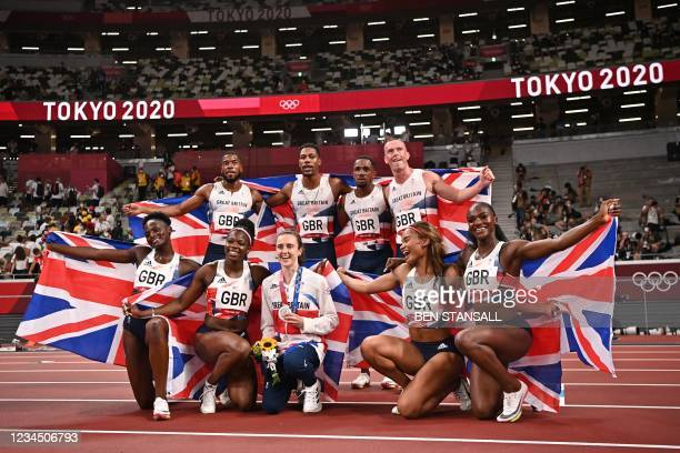 Second-placed in the women's 400m final Britain's Laura Muir poses with Britain's women teammates Daryll Neita, Asha Philip, Imani Lansiquot and Dina...