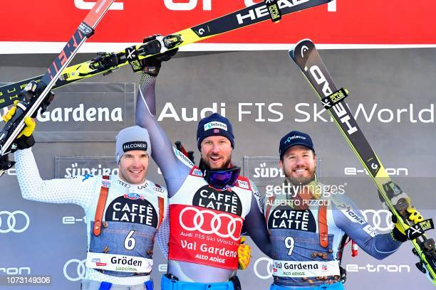 Secondplaced Italy's Christof Innerhofer winner Aksel Lund Svindal and thirdplaced Norway's Kjetil Jansrud celebrate on the podium after the FIS...