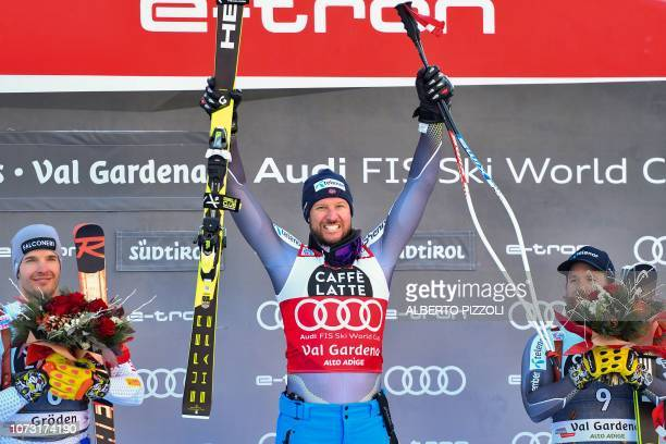Secondplaced Italy's Christof Innerhofer winner Norway's Aksel Lund Svindal and thirdplaced Norway's Kjetil Jansrud celebrate on the podium after the...