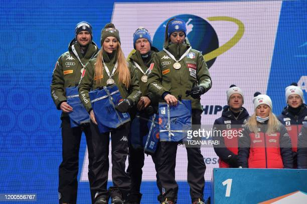 Second-placed Italy's Dominik Windisch, Italy's Dorothea Wierer, Italy's Lukas Hofer and Italy's Lisa Vittozzi pose with their silver medal on the...