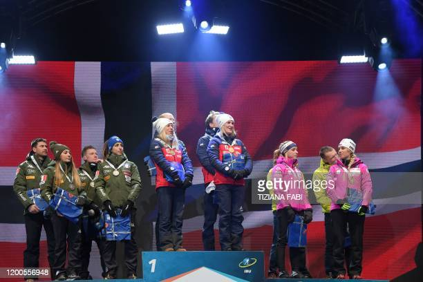 Second-placed Italy's Dominik Windisch, Italy's Dorothea Wierer, Italy's Lukas Hofer and Italy's Lisa Vittozzi, race winners Norway's Tiril Eckhoff,...