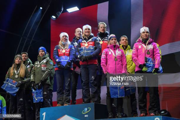 Second-placed Italy's Dorothea Wierer, Italy's Dominik Windisch and Italy's Lisa Vittozzi, race winners Norway's Tiril Eckhoff, Norway's Johannes...
