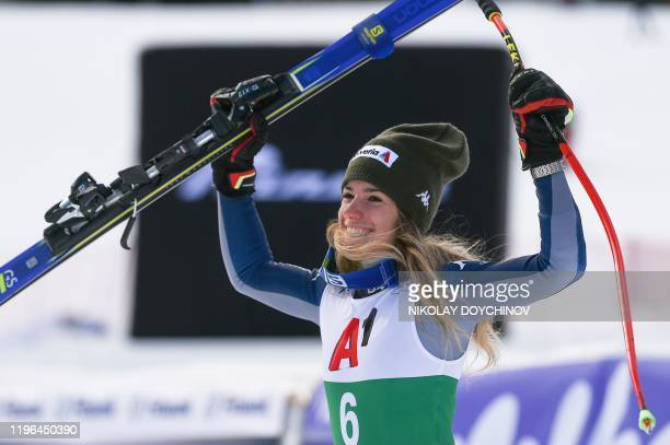 Second-placed Italy's Marta Bassino celebrates as she arrives on the podium after the women's Super-G event at the FIS ski alpine World Cup in Bansko...