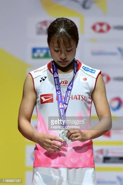 Secondplaced Japan's Nozomi Okuhara poses with her silver medal during the podium cermony after the women's singles final match againts India's...