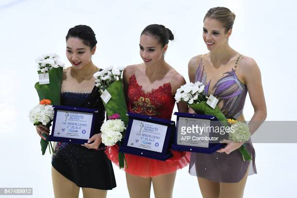 Secondplaced Japan's Wakaba Higuchi winner Russia's Alina Zagitova and thirdplaced Italy's Carolina Kostner pose on the podium after the Senior...