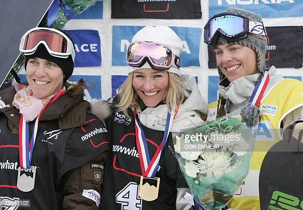 Second-placed Manuela Laura Pesko of Switzerland, gold medalist Gretchen Bleiler of the US and third-placed Holly Crawford of Australia pose on the...