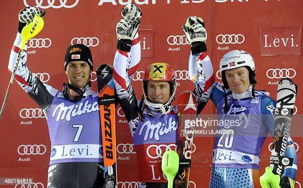 Secondplaced Mario Matt and winner Marcel Hirscher both of Austria celebrate on the podium with Norway's thirdplaced Henrik Kristoffersen after the...